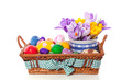 colorful easter eggs in a wicker bread basket decorated with kro