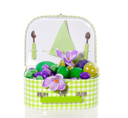 a picnic bag full of easter eggs decorated with flowers isolated
