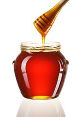 Jar of honey and dipper