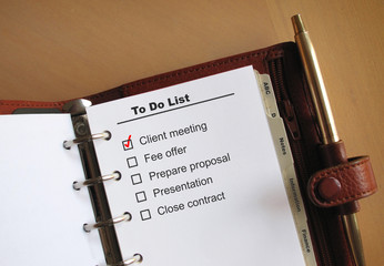 Business concepts to do list in a personal organizer