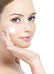 Face of girl applying cream