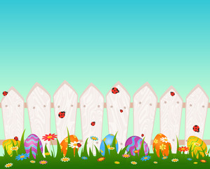 Wooden fanse with Easter colored eggs. Easter card