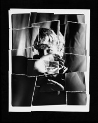 Torn Up Photo Of Child Blocking Face With Hand