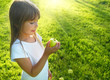 Little girl with apple, sunbeam in background