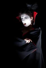 female vampire showing fangs