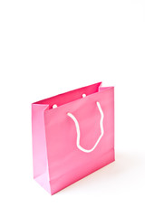 Pink shopping paper bag isolated on white background