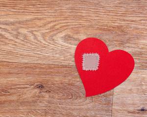 Broken heart on wooden floor with copy space
