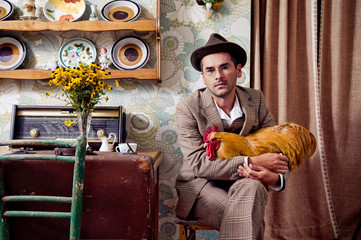 Retro guy holding his rooster