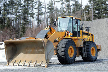 Close-up of front end loader in quarry