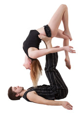 Young Couple Practices Acrobatic Balance