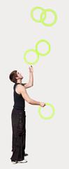 Young man juggling
