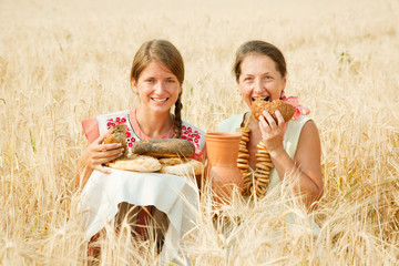 women with  farm-style meal