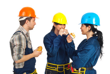 Team of workers eating sandwiches