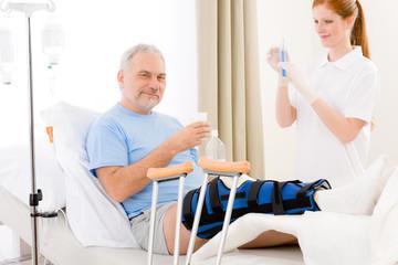 Hospital - female nurse syringe patient broken leg