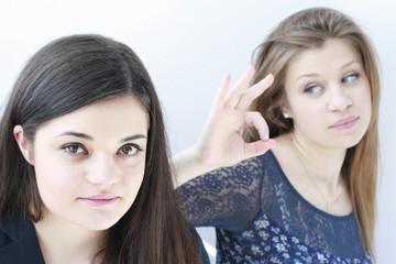 teenage school girls looking at the camera