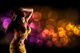 beautiful bellydancer in golden costume