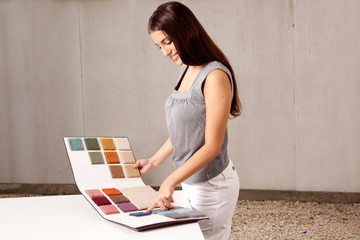 Interior Architect Choosing Rug Sample