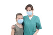 young doctor and school girl posing with mask