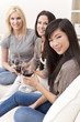 Interracial Group of Three Women Friends Drinking Wine