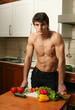 Young Muscular Man Preparing Salad