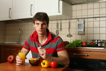 Young Sexy Man Eating His Breakfast