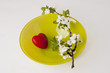 plum branch and heart on plate