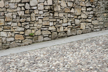 Wall and pavement.
