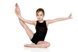 Girl performs simple gymnastic exercises
