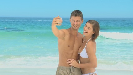 Cute couple taking a photo of themselves
