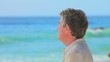Pensive mature man on beach