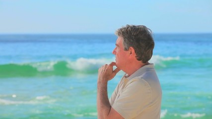 Pensive man looking at the sea
