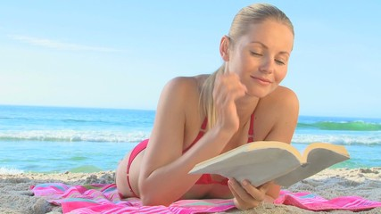 Pretty blonde woman reading a novel
