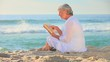 Mature woman reading reading on a beach