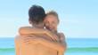 Sweet couple hugging on a beach