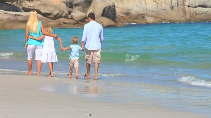 Family walking along a beach