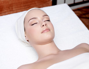 beautiful woman relaxing in a spa salon