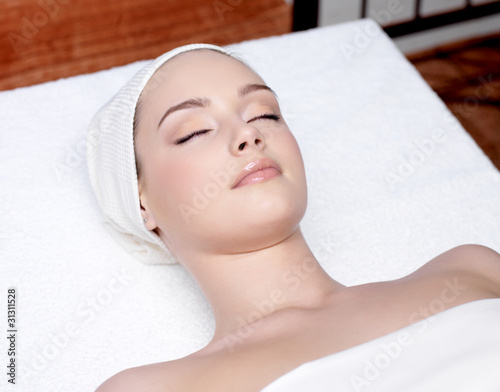 beautiful woman relaxing in a spa salon