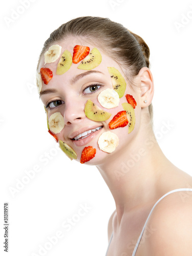 Smiling woman with fruit mask