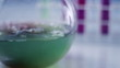 Scientist mixing fluids in Volumetric Flask, closeup