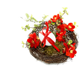 Easter decoration in red with Chaenomeles