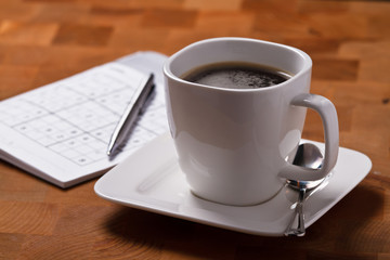 Coffee with sudoku puzzle