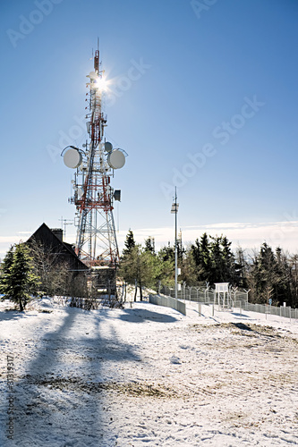 Mountain landscape with pylon of mobile transmitter.