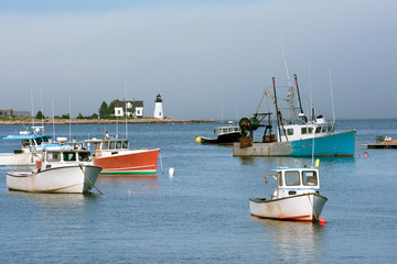 Fishing boats in Inner Harbor with lighthouse