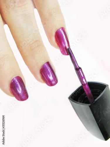 nail polisher making manicure - 31326964