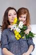 Girl embracing mom