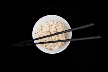 Bowl of rise with chopsticks