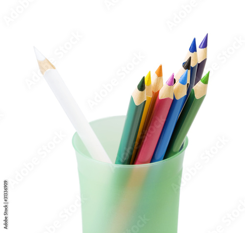 Color pencils in a glass on a white background