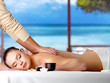 Relaxing woman having spa massage