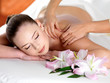 Spa massage on a shoulder for young beautiful woman