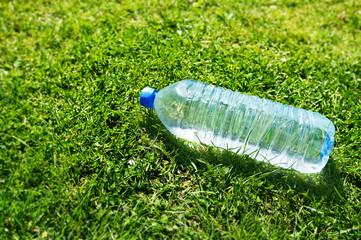 plastic water bottle on grass